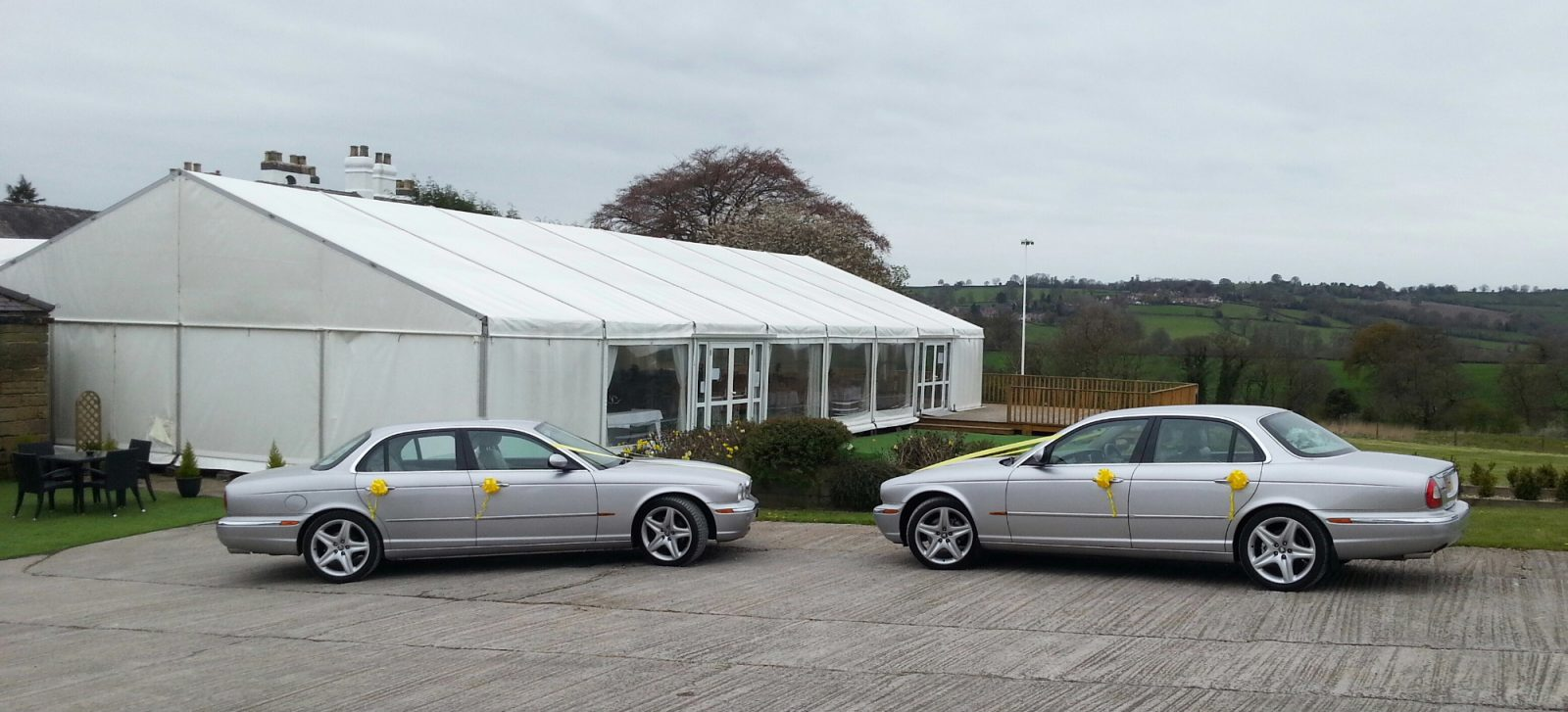 pair of silver jaguar limousines for wedding hire